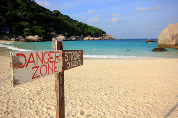 Sign of danger on the beach, Nangyuan island, Thailand