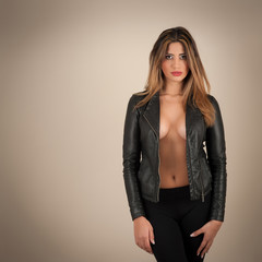 Sensual woman portrait wearing a leather jacket.