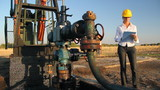 Business woman and oil pump jack