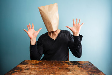 shocked man with bag over head
