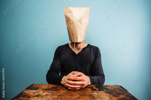 calm and relaxed man with bag over head