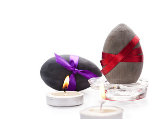Two Easter eggs and candles
