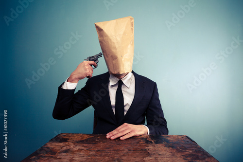 Businessman with bag over head comitting suicide