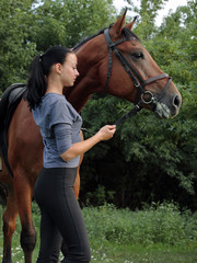 Young dressage rider with German riding pony