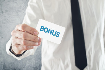 Businessman holding Bonus card.