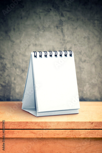 Blank desk calendar at office table