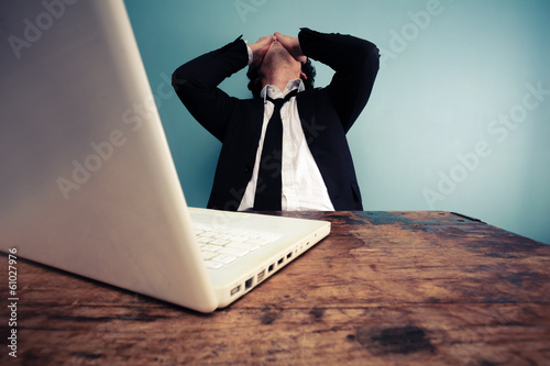 Upset businessman at laptop