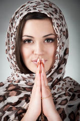 beautiful woman prays
