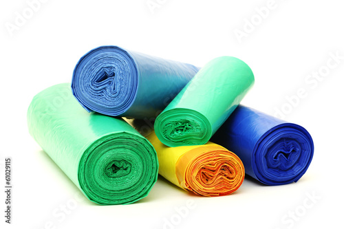 A lot of garbage bags rolls on a white background - 61029115