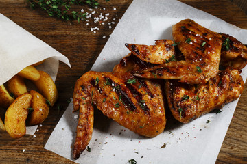 Grilled chicken wings with baked potatoes