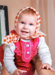 baby girl in a kerchief