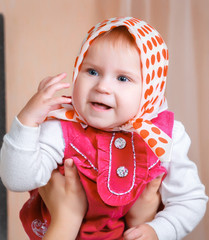baby girl in a kerchief