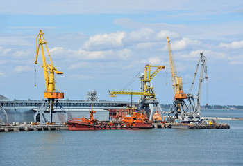 Bunker ship (fuel replenishment tanker) under port crane, Odessa