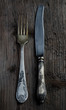 Vintage knife and  fork on a rustic table