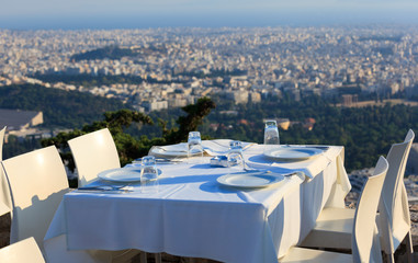 restaurant tables with panoramic view of Athens