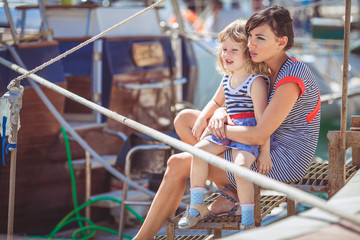 Happy Family having fun by the sea boats and yachts