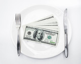 American US dollars in the white plate.