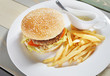 Hamburger with french fries and sauce