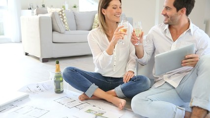 Couple at home celebrating new house purchase