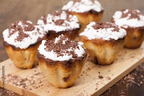 Cupcakes semolina with raisins, protein cream and chocolate.