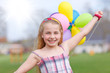 girl with balloons running