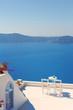 Obrazy na płótnie, fototapety, zdjęcia, fotoobrazy drukowane : Rooftop Chairs on Santorini Greece