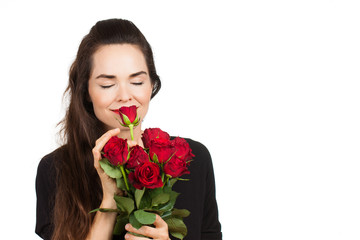 Woman smelling bunch of roses