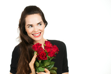 Smiling woman holding roses