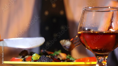 Man  eats with a cognac glass