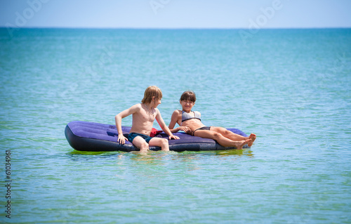 children having fun on air bed