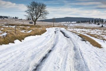 frozen winter asphalt road with snow