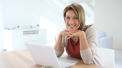 Businesswoman working from home in laptop computer