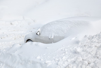Car under snow. Background of fresh snow