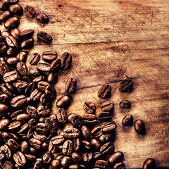 Roasted  coffee beans on vintage table. Coffee on grunge wooden