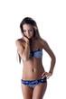 Lovely young girl advertises trendy striped bikini