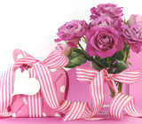 Beautiful pink gift and roses