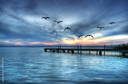 Fotobehang Een Hoekje om te Dromen se hace de noche en el mar