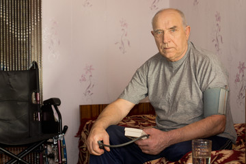 Senior man moniotoring his blood pressure