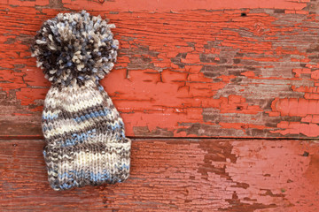 Cute warm woolen winter hat with a large pompom