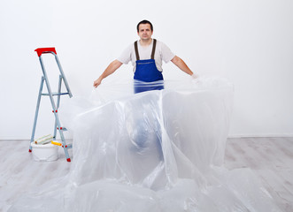 Worker preparing to paint a room