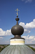 Dome with cross at the blue sky background