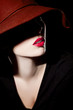 canvas print picture - Beautiful woman with hat and red lips