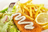 Fish and chips closeup with mayonnaise