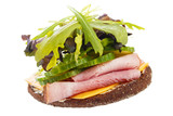 Rye bread sandwich with lot of salad , isolated