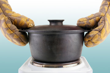 Oven mitts and hot cooking cauldron