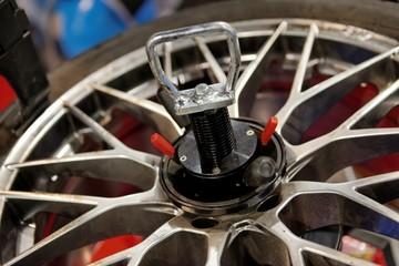 Automatic robot repairing wheel closeup