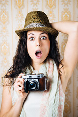 Hipster jaw dropped woman with camera