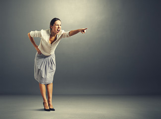 screaming young woman pointing