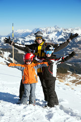 The father with two boys on ski resort
