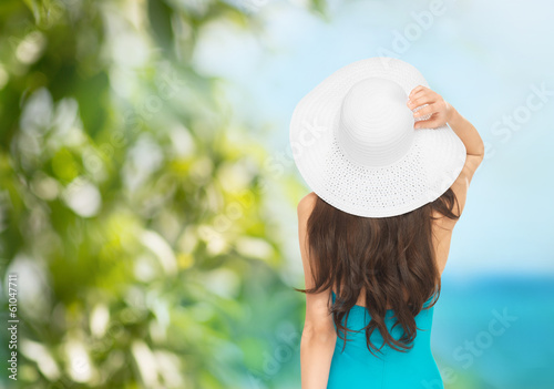 model in swimsuit with hat